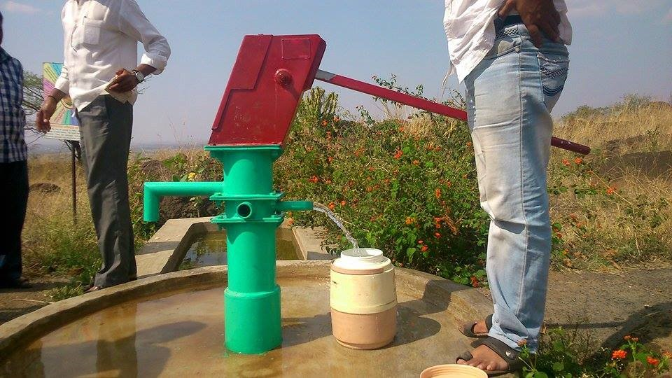 A solar pump plus hand-pump at a prominence inside village boundary